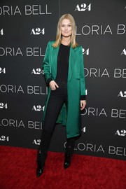 Toni Garrn teamed her coat with black split-hem jeans and a matching shirt.