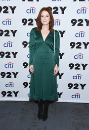 Julianne Moore styled her dress with black mid-calf boots.