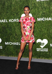 Herieth Paul put on a leggy display in a rose-print mini dress by Michael Kors at the 2018 Golden Heart Awards.