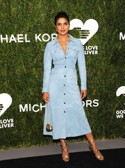 Priyanka Chopra's gold Dsquared2 lace-up heels were the perfect finishing touch to her stylish frock.