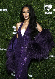 Winnie Harlow paired a purple feather bolero with a matching halter dress for the God's Love We Deliver Golden Heart Awards.