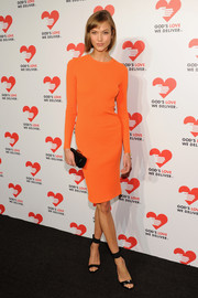 Karlie Kloss opted for an unadorned look with this orange Michael Kors sweater dress when she attended the Golden Heart Awards.