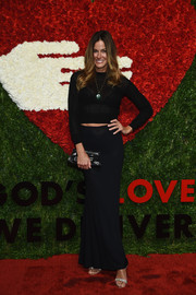 Kelly Bensimon chose a long black skirt to complete her outfit.