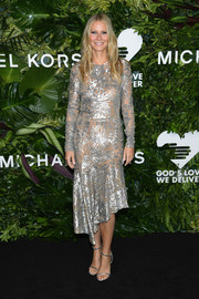 Gwyneth Paltrow complemented her dress with silver ankle-strap heels by Tamara Mellon.