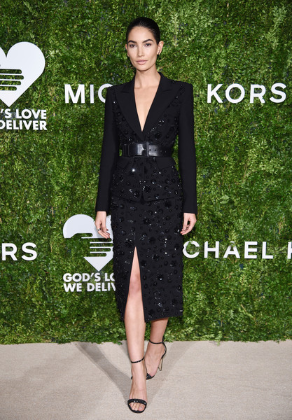 Lily Aldridge polished off her perfectly coordinated attire with embellished black sandals by Gianvito Rossi.