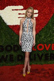 Kate Hudson was svelte and sophisticated at the God's Love We Deliver, Golden Heart Awards in a black-and-white Michael Kors floral halter dress with a neck-to-navel cutout.