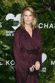 Alexandra Richards paired a black MICHAEL Michael Kors box clutch with a leopard-print wrap dress for the Golden Heart Awards.