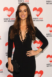Ariana Rockefeller completed her all-black ensemble at the Golden Heart Awards with a crescent-shaped quilted clutch.