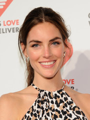 Hilary Rhoda styled her look with a pair of spiky gold earrings.