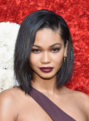 Chanel Iman achieved a bold and sexy beauty look with dark lipstick and smoky eyes.