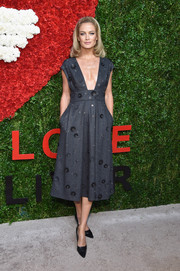 Carolyn Murphy's gray Michael Kors dress at the Golden Heart Awards struck the perfect balance between sweet, edgy, and sexy with its floral appliques, grommets, and super-low neckline.