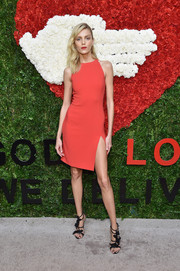Anja Rubik flaunted her supermodel pins at the Golden Heart Awards in a red Michael Kors dress with an up-to-there slit.