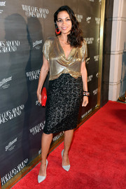 Rosario Dawson added more shimmer with a black sequin pencil skirt.