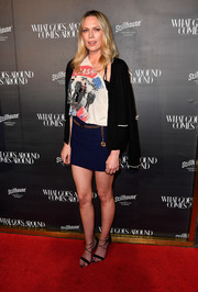Erin Foster teamed her shirt with a navy mini skirt.