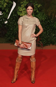 Jessica made a unique pairing while hitting the premiere of 'Goethe'. She completed her ruffled nude dress with tan over-the-knee boots and a matching clutch.
