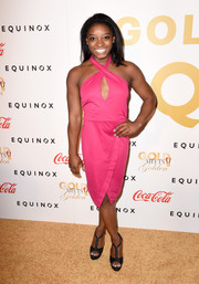 Simone Biles paired her sexy frock with black T-strap platform sandals.