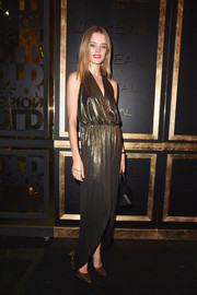 Natalia Vodianova looked divine in a shimmering halter gown while attending the Gold Obsession Party.