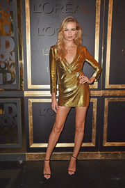 Natasha Poly sealed off her sexy outfit with a pair of skinny-strap heels.