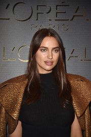 Irina Shayk opted for a simple center-parted style when she attended the Gold Obsession Party.