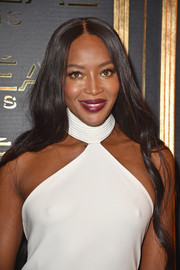 Naomi Campbell sported a subtly wavy center-parted hairstyle at the Gold Obsession Party.