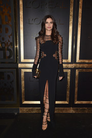 Sara Sampaio was sultry yet elegant in a high-slit, sheer-panel gown by David Koma at the Gold Obsession Party.