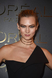 Karlie Kloss was futuristic-glam with her gold wraparound choker and one-shoulder dress.