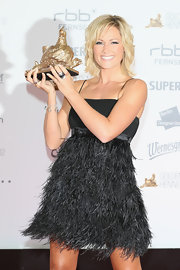 Helene Fischer worked it in a little black feather dress at the 2012 Goldene Henne Awards.