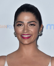 Camila Alves polished off her look with a pair of oversized diamond studs.