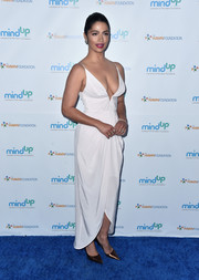 Camila Alves put on a sultry display in a plunging white slip dress by Zimmermann at the Love In For Kids event.