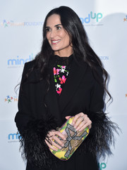 Demi Moore arrived for the Love In For Kids event carrying a sweet-looking bow-print clutch.