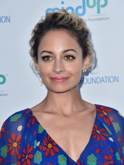 Nicole Richie swept her hair back into a curly updo for the Love In For Kids event.