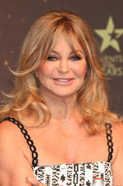 Goldie Hawn styled her hair with curly ends and parted bangs for her MindUP press conference.