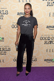 Joy Bryant went casual and playful in a gray slogan tee during the New York screening of 'Good Girls Revolt.'
