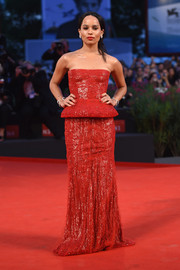Zoe Kravitz dazzled in a strapless red peplum gown by Armani Prive Couture at the 'Good Kill' premiere.