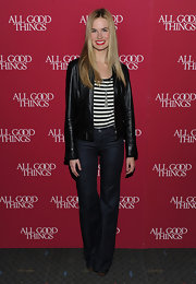 Alice opts for a casual red carpet look with her sleek leather jacket over a striped tee.