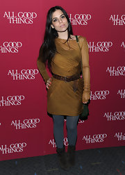 Ally Hilfiger donned earthy brown suede boots with charcoal tights and a chartreuse dress.
