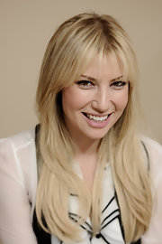 Ari Graynor wore her long layered locks with wispy lash-grazing bangs at the 2012 Sundance Film Festival.