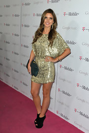 Audrina Patridge glittered on the red carpet at the Google music launch party in LA. She topped off her golden frock with black suede wedge booties.