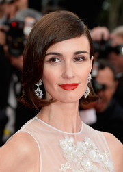 Paz Vega amped up the glamour with a swipe of rich red lipstick.