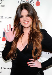 Khloe Kardashian wore classic red polish at the opening of Kardashian Khaos in Las Vegas.