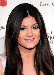 Kylie Jenner wore rosy pink gloss with a hint of shimmer at the opening of Kardashian Khaoe in Las Vegas.