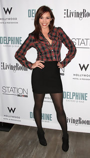 Jessica Sutta pulled off a corporate-ish ensemble by tucking in a button-down shirt inside a black mini skirt at the grand opening event of Delphine Restaurant.