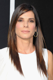 Sandra Bullock looked ultra modern at the 'Gravity' premiere with her choppy layers and asymmetrical-sleeve dress.