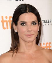 Sandra Bullock went for simple styling with this straight center-parted 'do during the premiere of 'Gravity.'