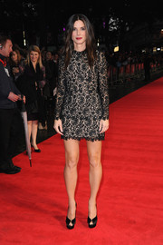 Sandra Bullock looked very dressy (and leggy) in a black lace Stella McCartney mini dress during the 'Gravity' screening in London.