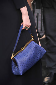 Florence Welch kept her look all blue with this electric blue leather purse that featured a snap closure.