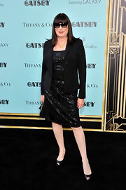 Anjelica Huston's beaded black frock gave the actress a sleek and modern evening look.