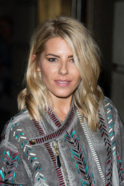 Mollie King wore a messy wavy 'do when she attended the Green Carpet Challenge BAFTA Night.