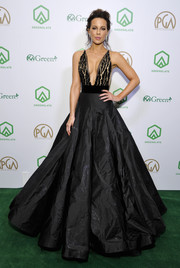 Kate Beckinsale wowed in a black Yanina Couture gown with a plunging neckline and a voluminous skirt at the 2019 Producers Guild Awards.