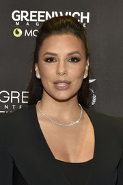 Eva Longoria Baston added a hint of sparkle with a diamond tennis necklace.